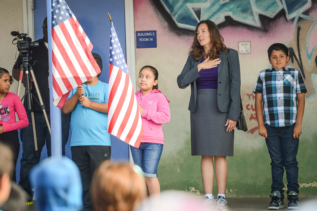 . Newly elected LAUSD school board member Monica Ratliff recites the pledge of allegiance with students at Fair Avenue school in North Hollywood Tuesday.  Tuesday is the first day of school for the Los Angeles Unified School District. Photo by David Crane/Los Angeles Daily News