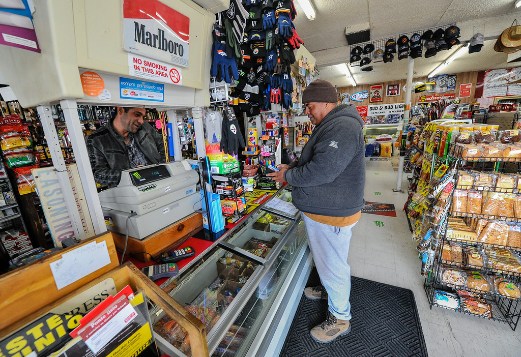 . A customer makes a purchase at the Hinkley Market & Gas general store in Hinkley, Calif. on Thursday, March 7, 2013. Hinkley\'s only retail store, which has been in operation for 50 years, is at risk of closing as more people leave town and the nearby school closes. (Rachel Luna / San Bernardino Sun)