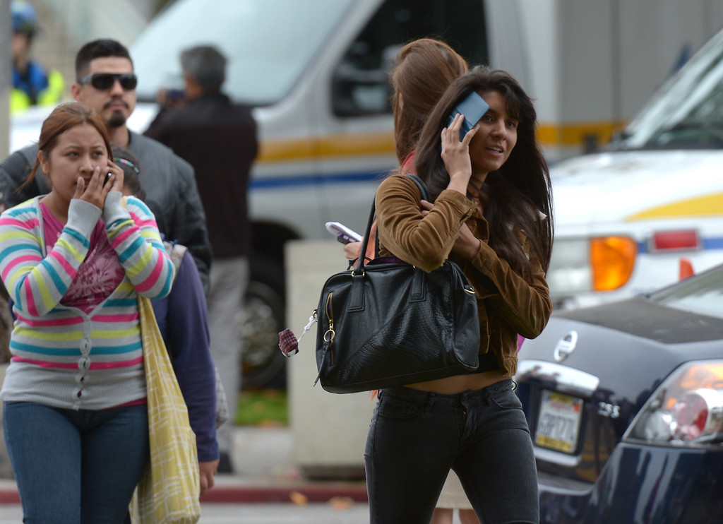 . Students leave the grounds of Santa Monica College after multiple shootings were reported on the campus June 7, 2013 in Santa Monica, California.  At least six people died in the shooting rampage before police shot and killed a black-clad gunman in the college library, police said.   (JOE KLAMAR/AFP/Getty Images)