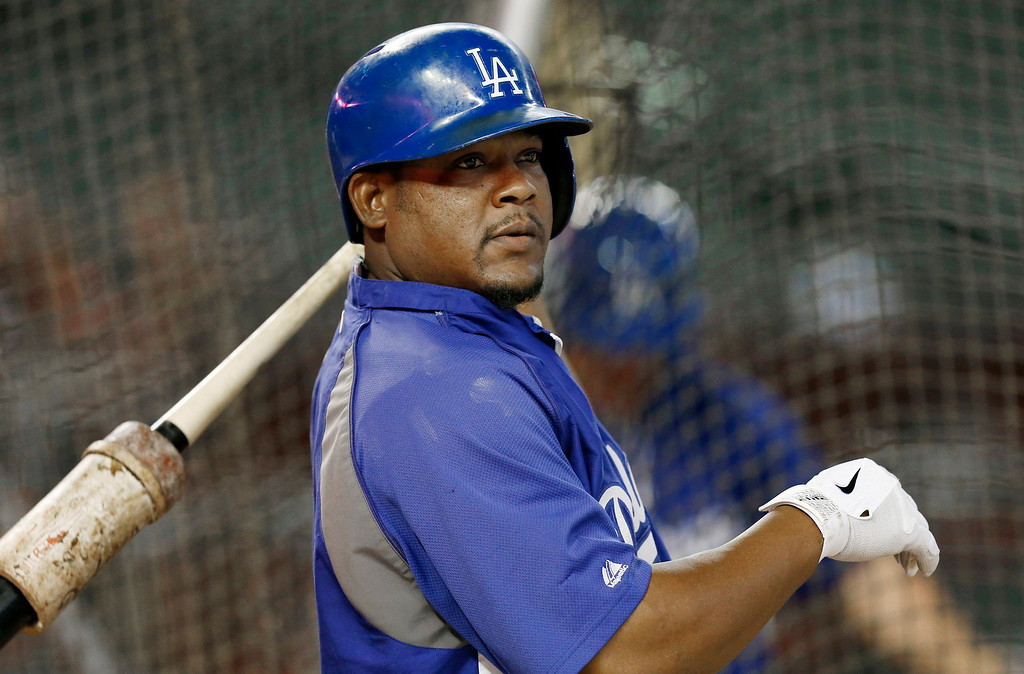 . Los Angeles Dodgers\' Juan Uribe takes a practice swing during batting practice prior to a baseball game against the Arizona Diamondbacks on Monday, Sept. 16, 2013, in Phoenix. (AP Photo/Ross D. Franklin)
