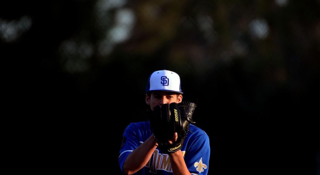 . San Dimas starting pitcher Peter Lambert (C) eyes the plate against Bonita in the first inning of a prep baseball game at Bonita High School in La Verne, Calif., on Wednesday, March 19, 2014.  (Keith Birmingham Pasadena Star-News)