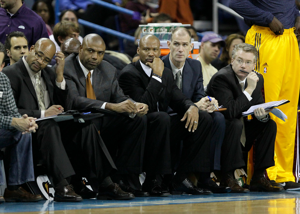 . Cleveland Cavaliers head coach Byron Scott, center, watches game action from the bench in the second half of an NBA basketball game against the New Orleans Hornets in New Orleans, Friday, Nov. 19, 2010. (AP Photo/Patrick Semansky)