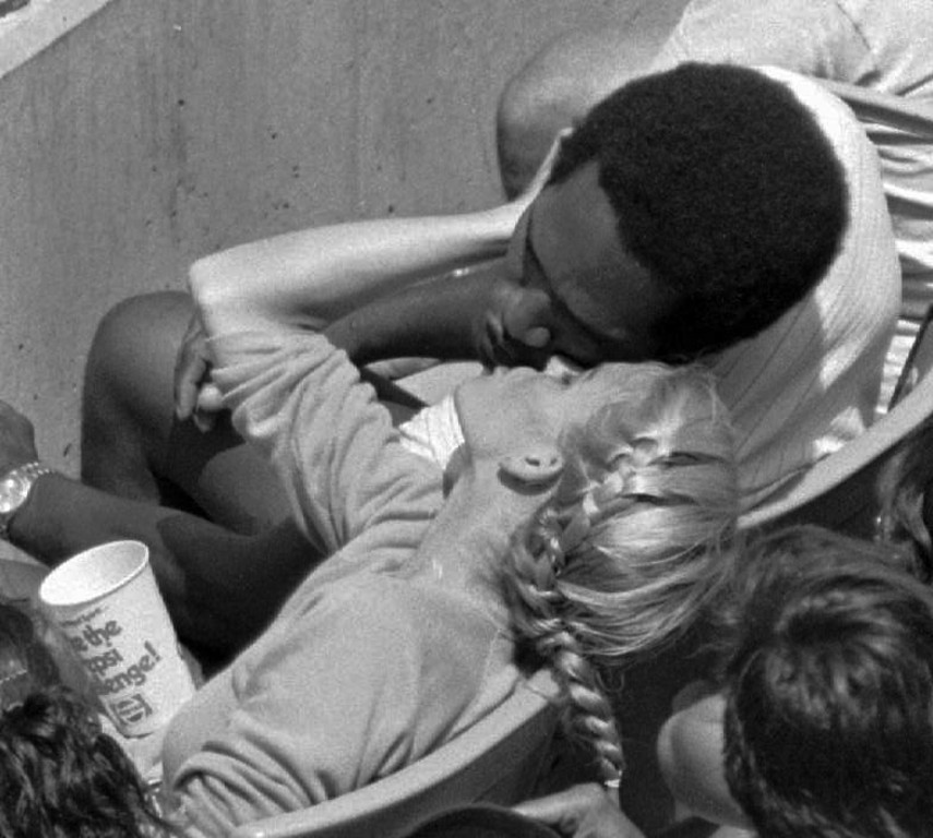 . O.J. Simpson kisses his fiancee, Nicole Brown, at Dodger Stadium during a game against the Cincinnati Reds in this Aug. 18 1980 photo.  (AP Photo)