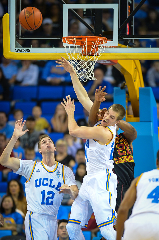 . UCLA�s Travis Wear is fouled by USC�s Byron Wesley during game action at Pauley Pavilion Sunday, December 5, 2014. UCLA  defeated USC 107-73.  Photo by David Crane/Los Angeles Daily News.