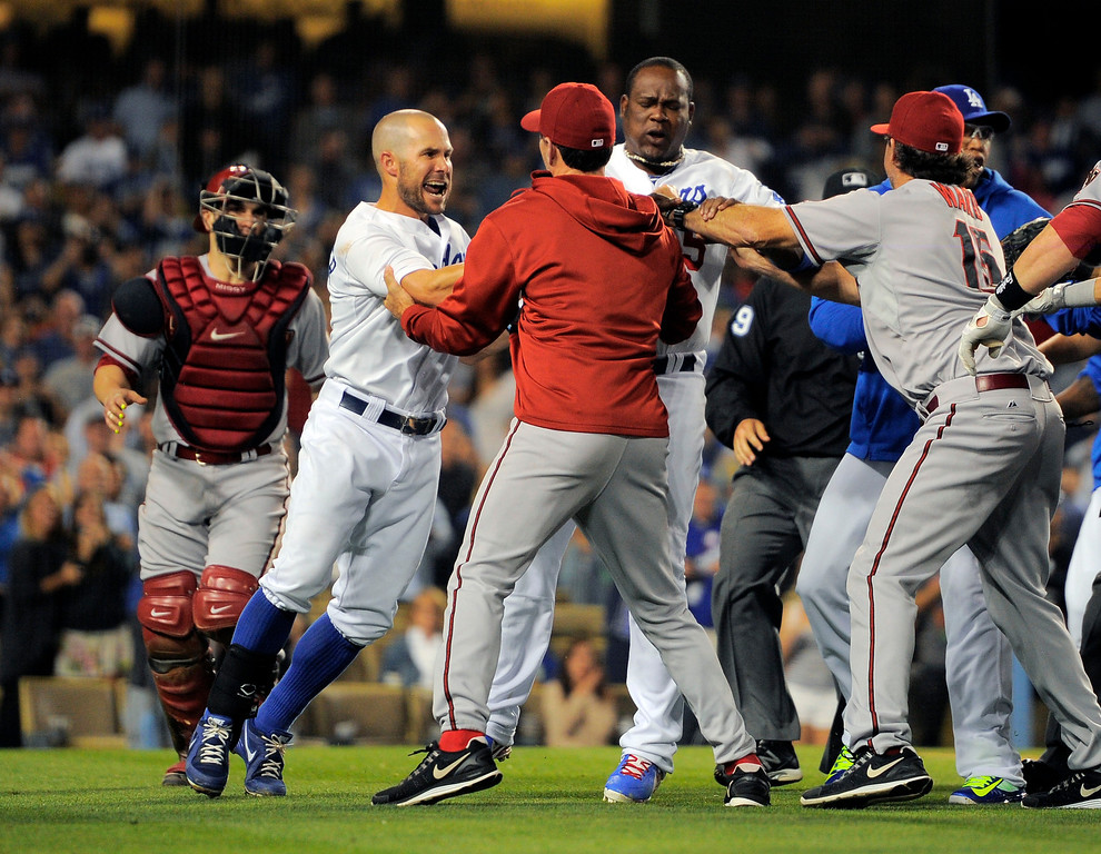 . A scuffle breaks out after Los Angeles Dodgers starting pitcher Zack Greinke was hit by a pitch during the seventh  inning of their baseball game against the Arizona Diamondbacks, Tuesday, June 11, 2013, in Los Angeles.  Dodgers won 5-3.   (AP Photo/Mark J. Terrill)