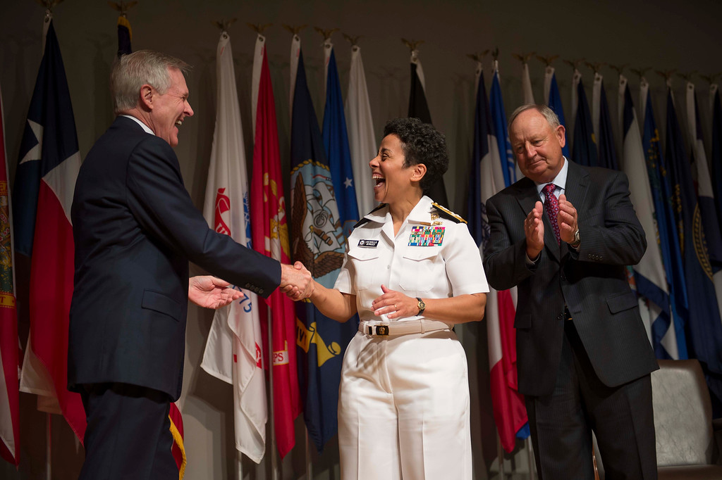 . Secretary of the Navy Ray Mabus,left, congratulates Adm. Michelle Howard after putting on her fourth star during her promotion ceremony at the Women in Military Service for America Memorial in Washington Tuesday July 1, 2014. Howard is the first woman to be promoted to the rank of admiral in the history of the Navy and will assume the duties and responsibilities as the 38th Vice Chief of Naval Operations from Adm. Mark Ferguson. Howard\'s husband Wayne Cowles is at right.  (AP Photo/ Chief Mass Communication Specialist Peter D. Lawlor)