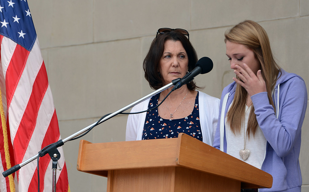 . Emily Taylor, right and Leslie Taylor speak during memorial service for fallen service members was held Friday May 17, 2013 in front of the Memorial Chapel at the university. The ceremony featured a special tribute to Keith Taylor, a University of Redlands alumnus and father of Emily Taylor, a University of Redlands student. Leslie Taylor is the widow of Keith Taylor. He was killed serving in Iraq. (Rick Sforza/Staff photographer, Redlands Daily Facts)