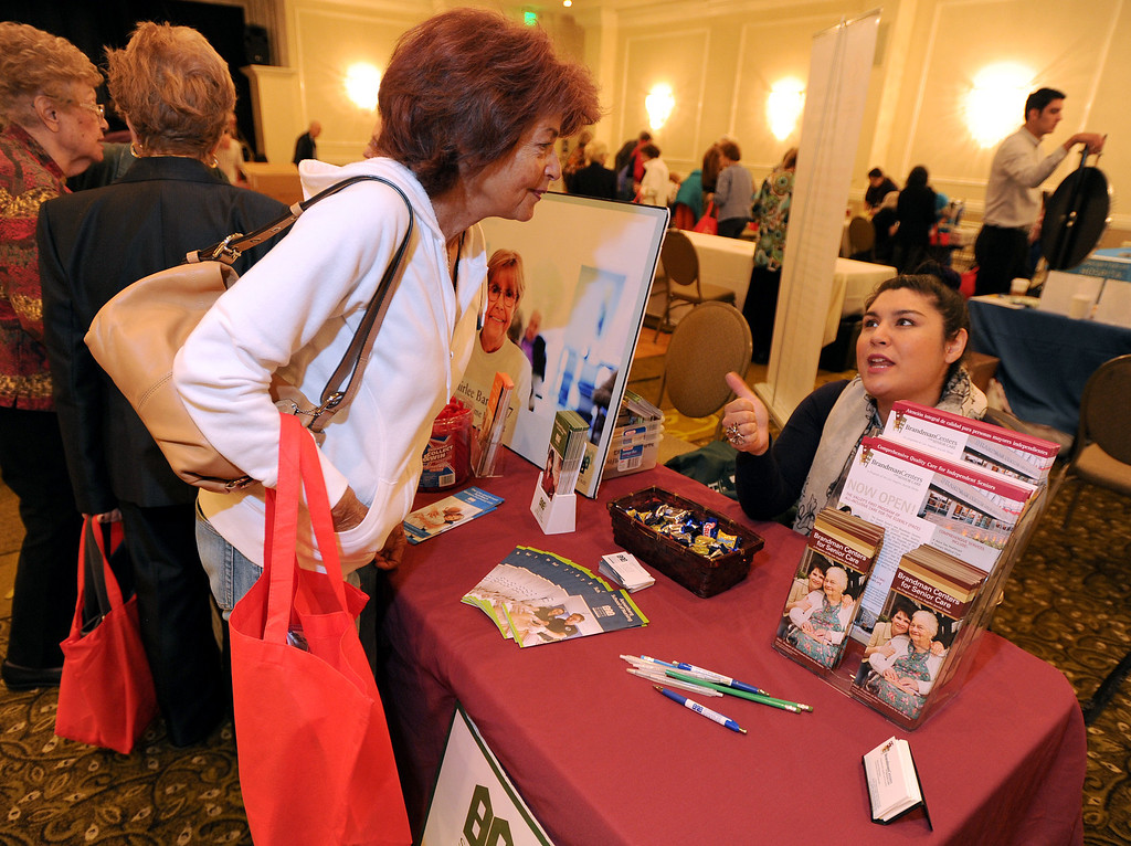 . (l-r) Laura Fiddler talks with Victoria Solorzano from Brandman Centers for Senior Care. The 4th annual Successful Aging Expo was held Saturday at the Sportsmen�s Lodge Events Center in Studio City, CA. 10/12/2013. photo by (John McCoy/Los Angeles Daily News)