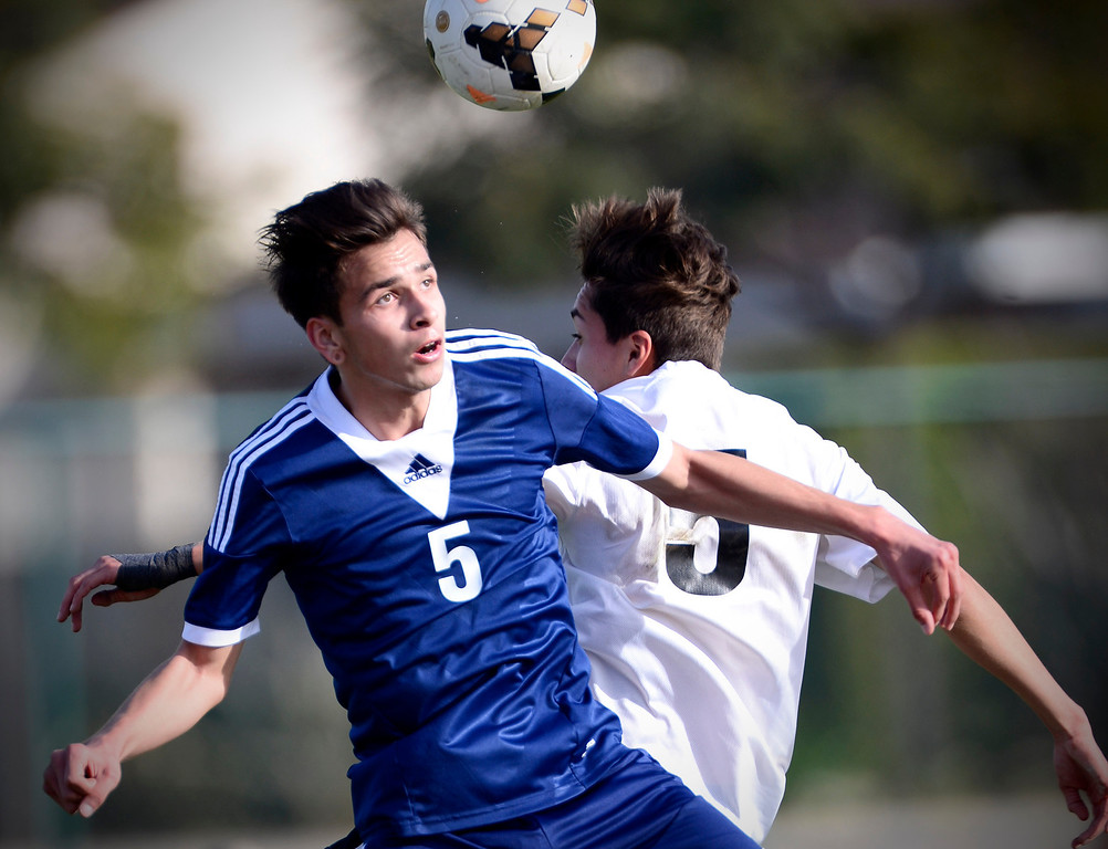 . Baldwin Park\'s Marcos Sanchez (5) and Northview\'s Carlos Maya (5) go for a header as Baldwin Park defeats Northview 2-0 during Tuesday\'s game at Northview High School, February 11, 2014. (Photo by Sarah Reingewirtz/Pasadena Star-News)