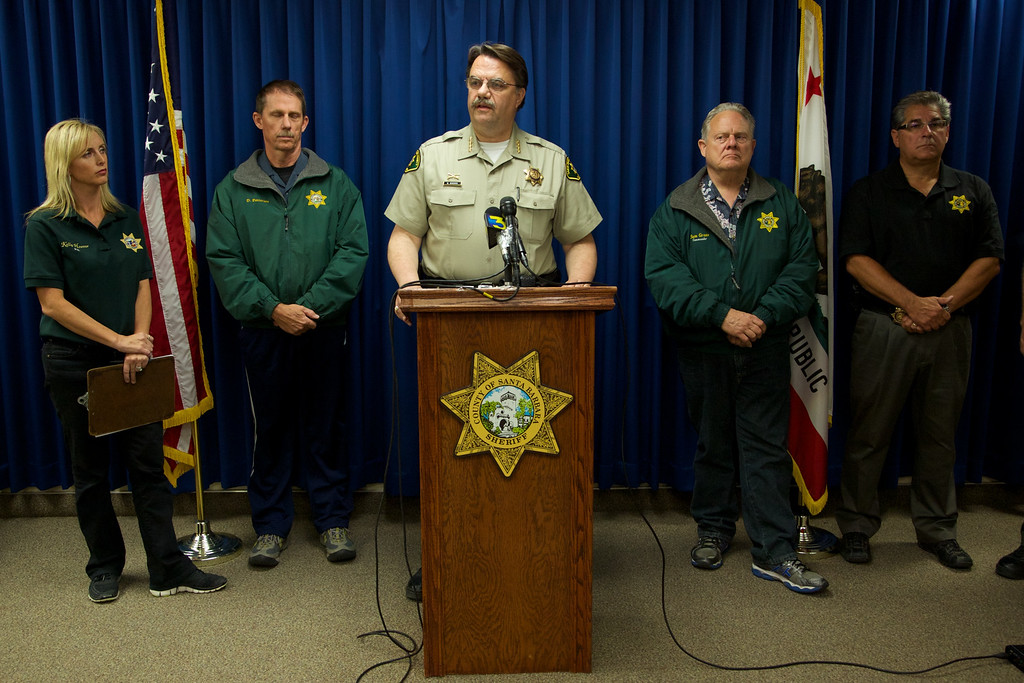 . Sheriff Bill Brown, center, speaks during a news conference at the Santa Barbara sheriffs office on Saturday, May 24, 2014, in Santa Barbara, Calif. A drive-by shooting on Friday left seven people dead, including the attacker, and others wounded in Isla Vista, Calif., authorities said Saturday. Alan Shifman an attorney for Hollywood director Peter Rodger, who was an assistant director on The Hunger Games, said the family believes Rodger\'s son, Elliot Rodger, is responsible for the shooting rampage near the Santa Barbara, California, university campus. Authorities have not confirmed the identity of the shooter. (AP Photo/The News-Press, Peter Vandenbelt)