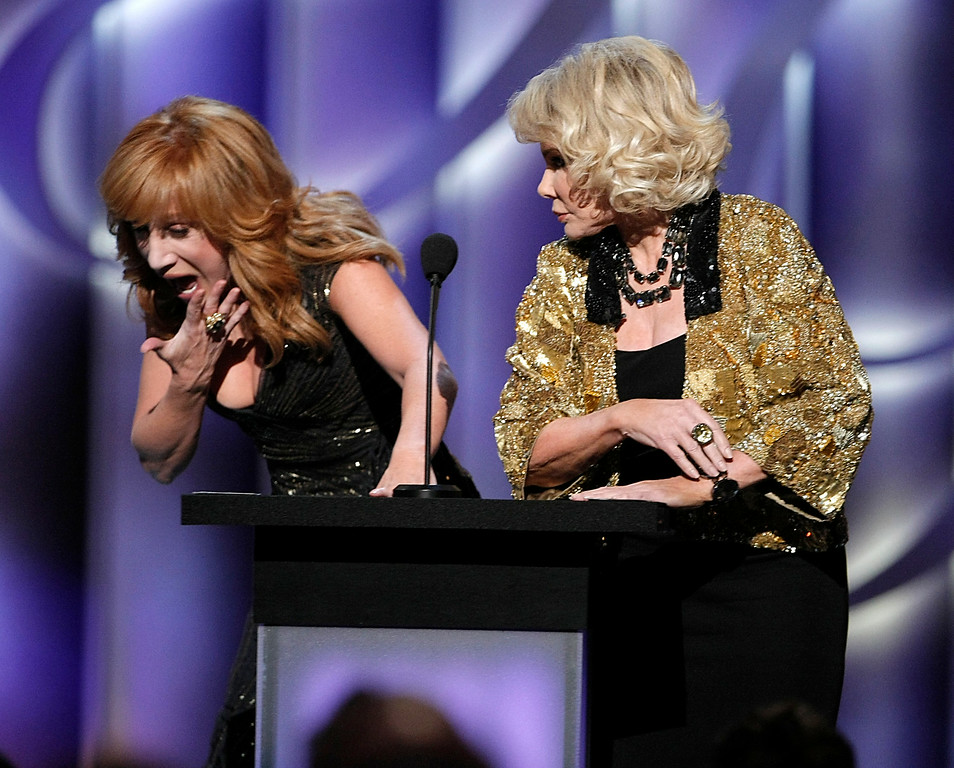 ". Comedienne and roast master Kathy Griffin, left, winces as comedienne and roastee Joan Rivers pretends to slap her face at the ""Comedy Central Roast of Joan Rivers\"" in Los Angeles on Sunday, July 26,  2009. (AP Photo/Dan Steinberg)"