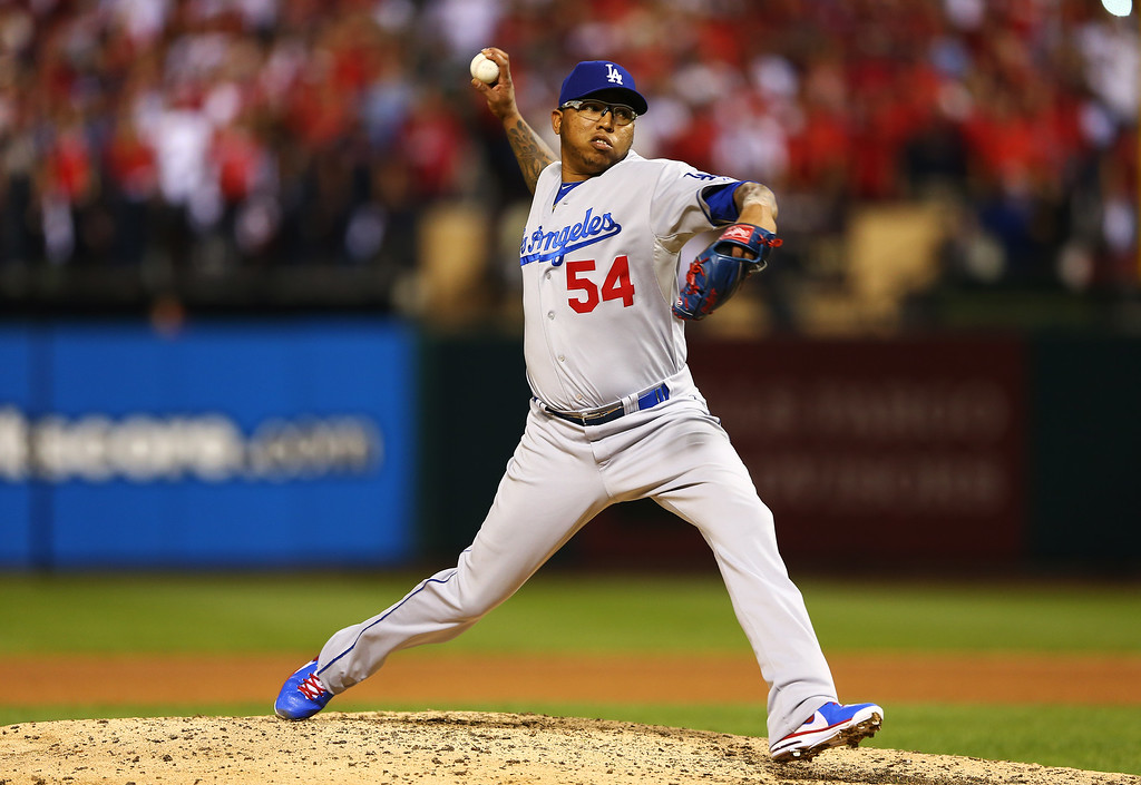 . ST LOUIS, MO - OCTOBER 11:  Ronald Belisario #54 of the Los Angeles Dodgers pitches in the 10th inning against the St. Louis Cardinals during Game One of the National League Championship Series at Busch Stadium on October 11, 2013 in St Louis, Missouri.  (Photo by Elsa/Getty Images)