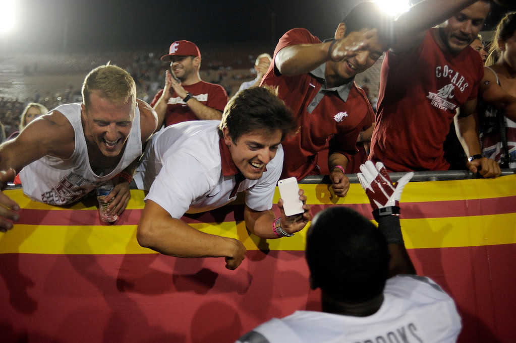 . Washington State players celebrated after defeating USC during their game at the Los Angeles Memorial Coliseum  Saturday, September 7, 2013. Washington State beat USC10-7. (Photo by Hans Gutknecht/Los Angeles Daily News)