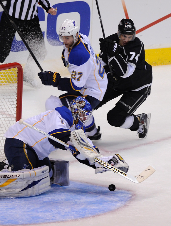. St. Louis Blues\' goalkeeper Brian Elliott falls on the puck as Alex Pietrangelo and the Kings\' Dwight King close in in the first period, Monday, May 6, 2013, at Staples Center. (Michael Owen Baker/Staff Photographer)
