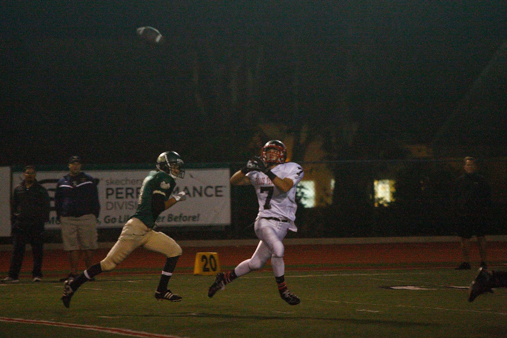 . Wide receiver Lance Brown #7 of Palos Verdes catches a pass for a touchdown against the defense of Mira Costa in a Bay League matchup at Mira Costa High School on Friday, October 18, 2013 in Manhattan Beach, Calif.  (Michael Yanow / For the Daily Breeze)
