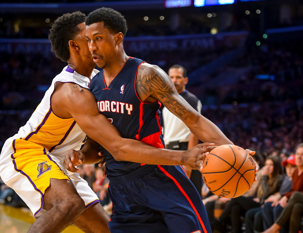 . Detroit�s Kentavious Caldwell-Pope drives around Lakers� Nick Young during second half action at Staples Center Sunday, November 17, 2013.  The Lakers defeated the Detroit Pistons 114-99.  ( Photo by David Crane/Los Angeles Daily News )