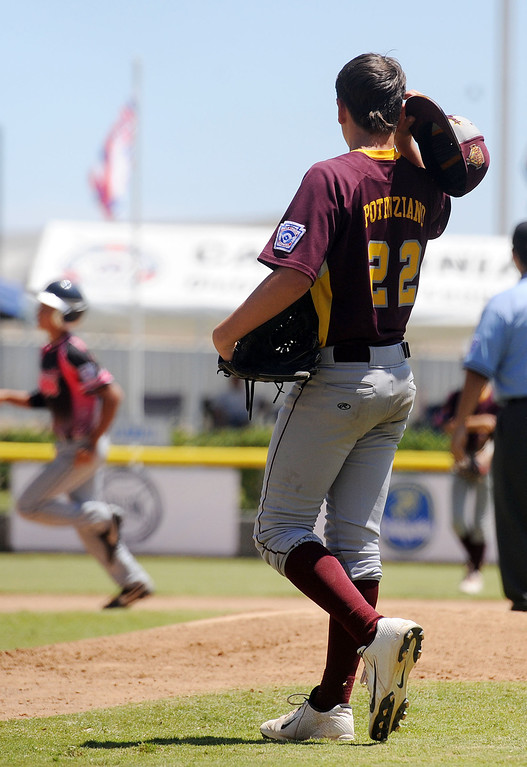 . (Will Lester/Inland Valley Daily Bulletin) Chandler Little League, from Chandler, Arizona, eliminates Central East Maui, from Hawaii, with a 5-3 win Wednesday August 7, 2013 11-3 at the Little League Western Regional Tournament at Al Houghton Stadium in San Bernardino.