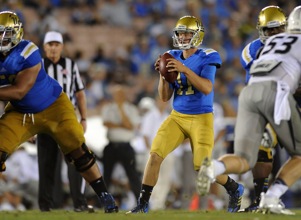 . UCLA QB Jerry Neuheisel takes snaps in the fourth quarter against Nevada, Saturday, August 31, 2013, at the Rose Bowl. (Michael Owen Baker/L.A. Daily News)