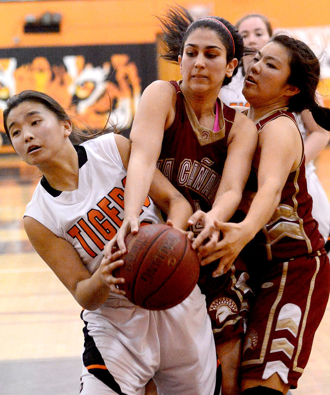 . South Pasadena\'s Michelle Gin (12) struggles with La Canada for the ball during South Pasadena\'s 66-58 win Friday night, January 31, 2014 at South Pasadena High School. (Photo by Sarah Reingewirtz/Pasadena Star-News)