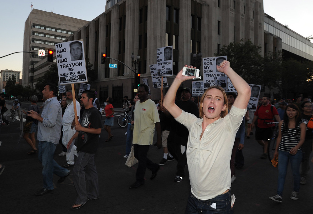 . A group of nearly 100 people, protesting the Trayvon Martin verdict, gathered at Los Angeles City Hall, and then marched a circular route that concluded at the Police Administration Building in Los Angeles, CA. 7/16/2013(John McCoy/LA Daily News)