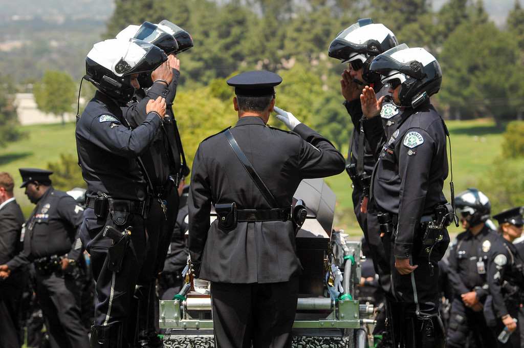 . LAPD officers salute at the casket of LAPD officer Chris Cortijo, Tuesday, April 22, 2014, at Forest Lawn Hollywood Hills. (Photo by Michael Owen Baker/L.A. Daily News)