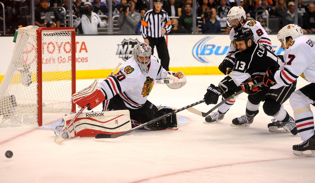 . The Kings\' Kyle Clifford stretches for the puck after a snapshot deflected off Blackhawks goalie Corey Crawford game six of the Western Conference Finals, Friday, May 30, 2014, at Staples Center. (Photo by Michael Owen Baker/Los Angeles Daily News)