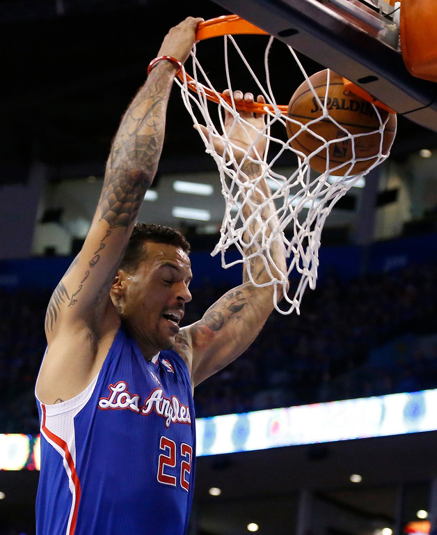 . Los Angeles Clippers forward Matt Barnes dunks in the first quarter of Game 1 of the Western Conference semifinal NBA basketball playoff series against the Oklahoma City Thunder in Oklahoma City, Monday, May 5, 2014. (AP Photo/Sue Ogrocki)