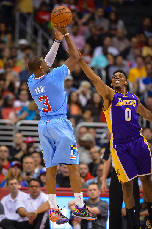 . Clippers Chris Paul goes up for a shot as Lakers� Nick Young tries to block during game action at Staples Center Sunday April 6, 2014. Clippers defeated the Lakers 120-97.  ( Photo by David Crane/Los Angeles Daily News )