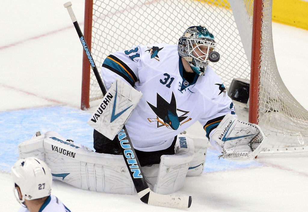 . San Jose Sharks goalie Antti Niemi blocks a shot by Los Angeles Kings defenseman Drew Doughty (not pictured) during the second period in Game 4 of an NHL hockey first-round playoff series at Staples Center in Los Angeles on Thursday, April, 24  2014.  (Keith Birmingham Pasadena Star-News)