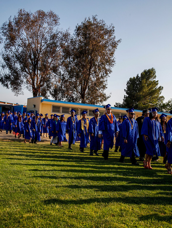 """. The 2013 graduating class reach the football field, to the music, \""""Pomp and Circumstance\"""", played by the Poly High School band, at John H Francis Polytechnic High School, Sun Valley, Calif., June 7, 2013. Photo: Lynn Levitt."""