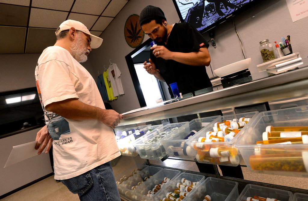 . Frank Foytik, 48, of San Bernardino, gets a medicinal Marijuana prescription filled by Eddie Robles, at the Inland Empire Patient\'s Health and Wellness Center in Riverside February 25, 2013.  GABRIEL LUIS ACOSTA/San Bernardino Sun