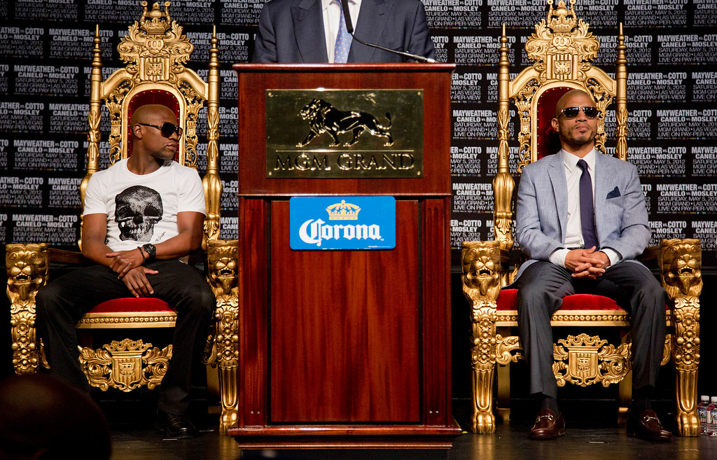 . Floyd Mayweather Jr., left, and Miguel Cotto wait to speak during a news conference, Wednesday, May 2, 2012, in Las Vegas. Mayweather and Cotto will fight for the WBC super welterweight diamond belt on Saturday. (AP Photo/Julie Jacobson)