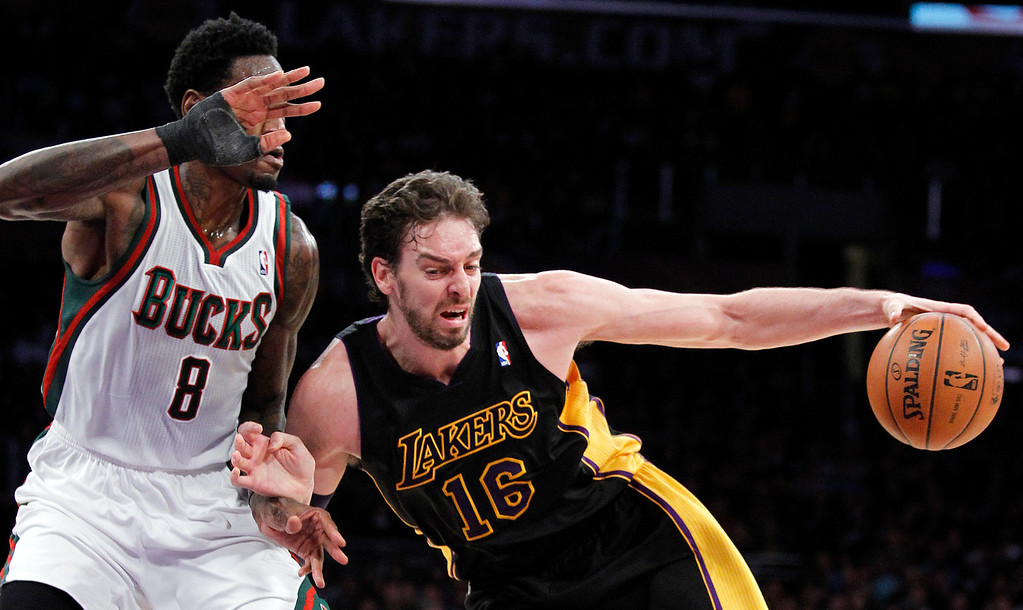 . Los Angeles Lakers center Pau Gasol (16), of Spain, drives against Milwaukee Bucks center Larry Sanders (8) defending during the first half of an NBA basketball game Tuesday, Dec. 31, 2013, in Los Angeles. (AP Photo/Alex Gallardo)