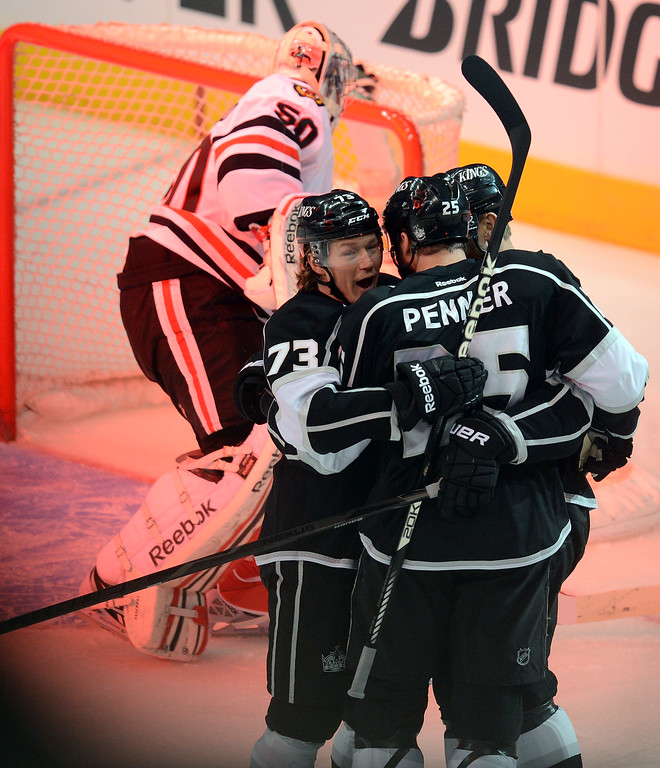 . Kings\'  Tyler Toffoli #73 hugs Dustin Penner #25 after Penner scored in the 2nd against the Blackhawks  to make it 2-1 during game 4 of the Western Conference finals at the Staples Center in Los Angeles June 6, 2013. (David Crane/Los Angeles Daily News)