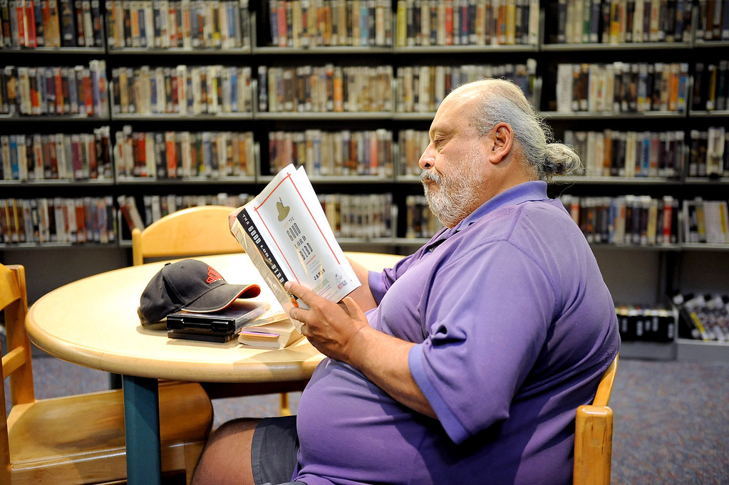 . Andrew Escarcega reads a book at the the Mid-Valley Library January 10, 2014 in North Hills, CA.  Starting January 12, 2014 the Los Angeles Public Library�s Central Library and eight regional branch libraries will be open on Sundays from 1 to 5 p.m.(Andy Holzman/Los Angeles Daily News)