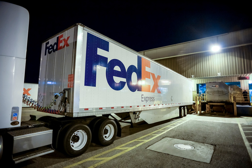 ". At 5am sorted packages move out on trucks at the FedEx LAX Regional Hub to be distributed to Southern California on ""Cyber Monday\"", December 2, 2013.  (Photo by David Crane/Los Angeles Daily News)"