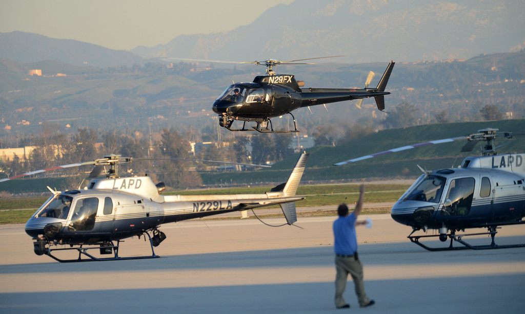 . Various police agencies stage at San Bernardino International Airport Tuesday, February 12, 2013, in San Bernardino in response to a shoot with Christopher Dorner. (Staff photo by Jennifer Cappuccio Maher/Inland Valley Daily Bulletin)