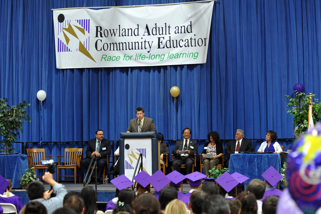 . Graduates receive their diplomas during the Rowland Adult and Community Education Graduation Ceremony at Rowland High School in Rowland Heights on Tuesday June 4, 2013. The 18 graduates and one special recipient received their honors in front of their families in the Gym. (SGVN/Staff Photo by Keith Durflinger)