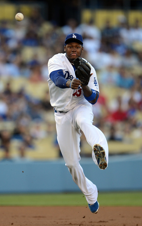 . The Dodgers\' Hanley Ramirez #13 throws out the Reds\' Brandon Phillips #4 at 1st base during their game at Dodger Stadium in Los Angeles Saturday, July 27, 2013. (Hans Gutknecht/Los Angeles Daily News)