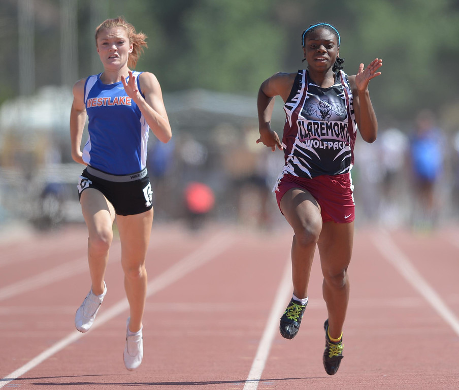 . Claremont\'s Brittany Brown wins the 100 meter Division 2 race of the CIF Southern Section Track and Field Championships over Westlake\'s Abigail Smith Saturday at Mt. SAC. 20130518 Photo by Steve McCrank / Staff Photographer