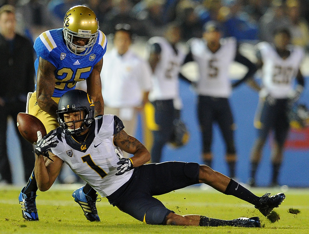 . UCLA safety Brandon Sermons (25) knocks a pass away from California wide receiver Bryce Treggs (1) during the first half of their college football game in the Rose Bowl in Pasadena, Calif., on Saturday, Oct. 12, 2013.   (Keith Birmingham Pasadena Star-News)