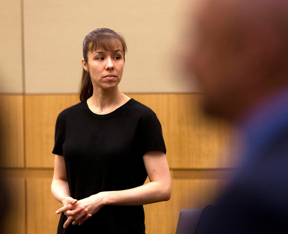 . Jodi Arias stands as the jury enters the courtroom on Wednesday, May 22, 2013 during the penalty phase of her murder trial at Maricopa County Superior Court in Phoenix.  Jodi Arias was convicted of first-degree murder in the stabbing and shooting to death of Travis Alexander. (AP Photo/The Arizona Republic, Rob Schumacher, Pool)