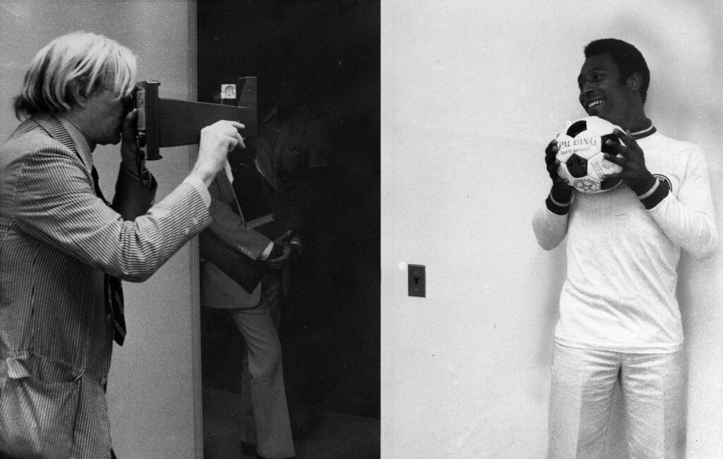 . Artist Andy Warhol, left, makes a photograph of soccer superstar Pele on July 26, 1977. Warhol plans to use the photograph when painting a portrait of Pele. Warhol has been commissioned to make a series of portraits of athletic stars. (AP Photo/Claudia Larson)