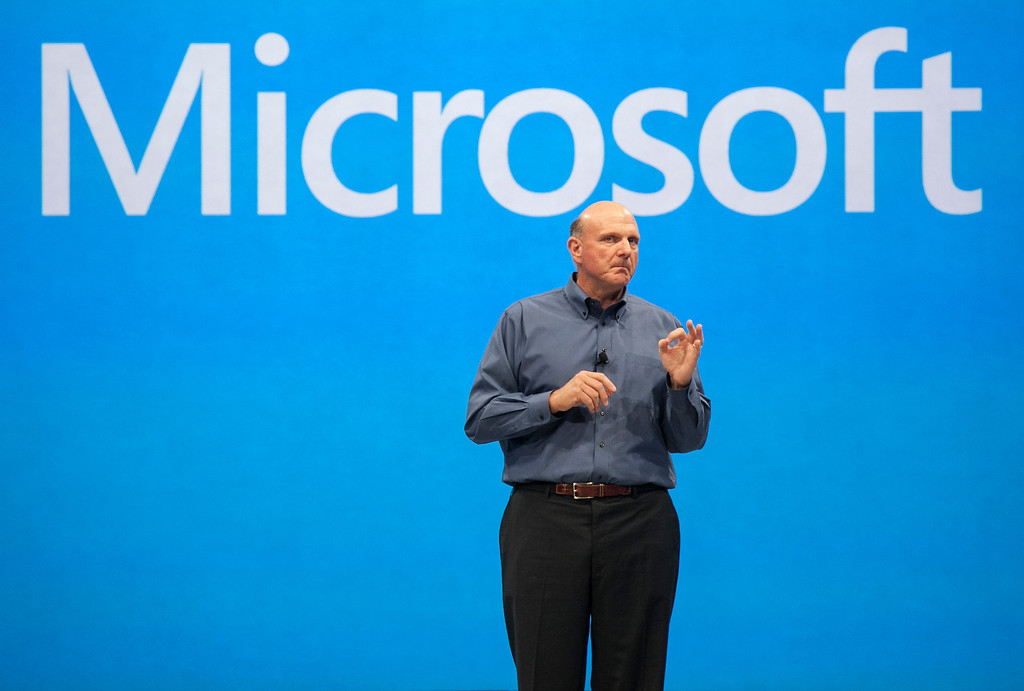 ". Microsoft CEO Steve Ballmer unveils its""Surface\"", a new tablet computer to compete with Apple\'s iPad at Hollywood\'s Milk Studios in Los Angeles Monday, June 18, 2012.  (AP Photo/Damian Dovarganes)"