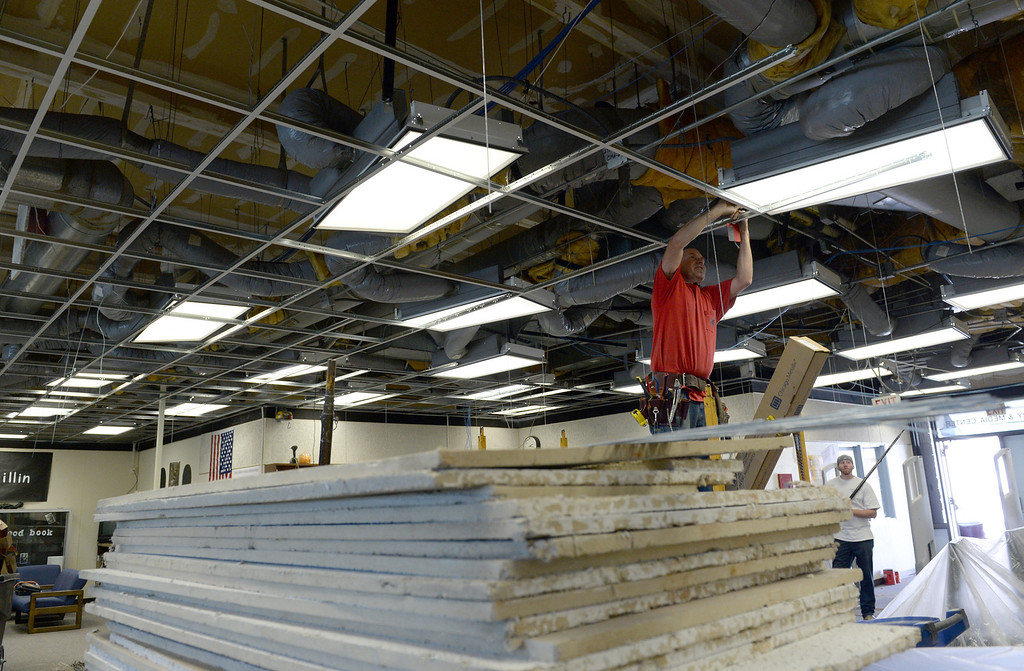 . Contractors work on replacing an earthquake damaged suspended ceiling in the library at Diamond Bar High School on Thursday April 3, 2014. Spring break repairs got more complicated after the recent earthquake damaged areas of the school in addition to planned repairs on campus. (Staff Photo by Keith Durflinger/Whittier Daily News)