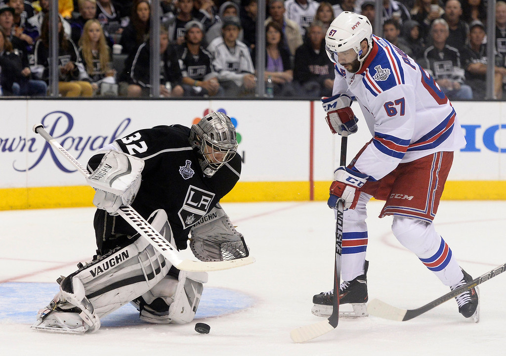 . Kings#32 Jonathan Quick stops a shot by Rangers#67 Benoit Pouliot in the 2nd period. The Los Angeles Kings faced the New York Rangers in game 2 of the Stanley Cup Final.  Los Angeles, CA. 6/7/2014(Photo by John McCoy Daily News)
