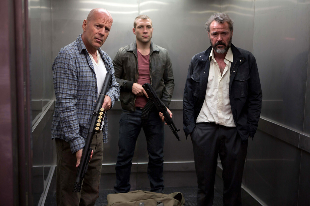 ". FILE - This publicity film image released by 20th Century Fox shows Bruce Willis as John McClane, left, Jai Courtney as his son Jack, center and Sebastian Koch as Komarov in a scene from ""A Good Day to Die Hard.\"" (AP Photo/20th Century Fox, Frank Masi, File)  (Movie released on January 31, 2013)"