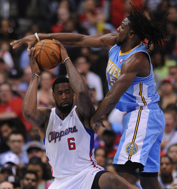 . Clippers#6 DeAndre Jordan gets fouled by Denver#35 Kenneth Faried in the second half. The Los Angeles Clippers defeated Denver Nuggets 117 to 105 in a regular season NBA game. Los Angeles, CA. 4/15/2014(Photo by John McCoy / Los Angeles Daily News)