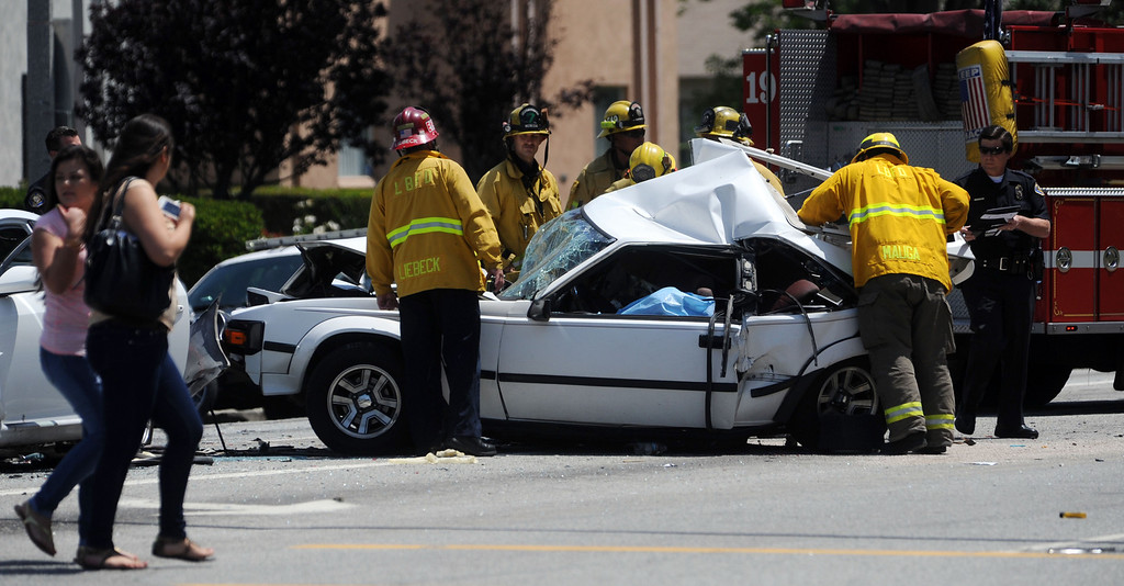 . Long Beach, Calif., -- 05-15-13-  Long Beach Police and Fire Department on the scene of a fatal hit and run accident involving four cars at the corner of Clark Ave. and Carson Street.  LBPD later caught the hit and runs suspect behind the LBCC auditorium and was positively identified by a witness.     Stephen Carr/  Los Angeles Newspaper Group