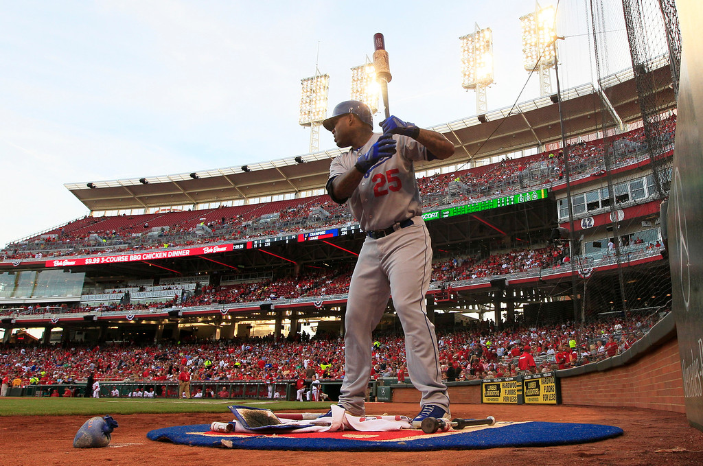 . Los Angeles Dodgers\' Carl Crawford (25) waits to bat against the Cincinnati Reds in the first inning of a baseball game, Friday, Sept. 6, 2013, in Cincinnati. (AP Photo/Al Behrman)